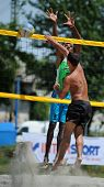 KAPOSVAR, HUNGARY - AUGUST 4: Leonel Munder (in green) in action at a ROAK Viragfurdo Kupa beach vol