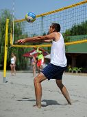 KAPOSVAR, HUNGARY - AUGUST 4: Tamas Vajda in action at a ROAK Viragfurdo Kupa beach volleyball competition, August 4, 2013 in Kaposvar, Hungary.