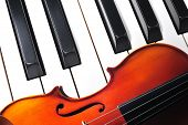 stock photo of violin  - Violin and piano keyboard closeup part fot music background - JPG