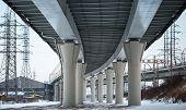 Urban Scene With Bottom View Of Steel Automotive Bridge