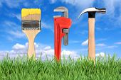 Home Improvement Tools Paintbrush, Pipe Wrench And Hammer