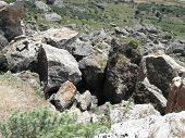Collapse of huge rocks as a result of an earthquake