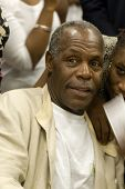 Actor Danny Glover With A Fan 1