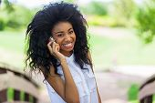 Teenage African American Girl Using A Mobile Phone