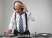 pic of grandpa  - a very funky elderly grandpa dj mixing records - JPG
