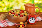 image of lenten  - Oatmeal with fruits on table on bright background - JPG