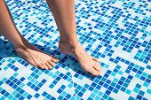 Overhead View Of Woman's Legs In Pool