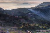 stock photo of plateau  - Rolling hills at sunrise in Dieng Plateau - JPG