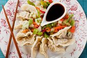 Dim Sum, asian cooked dumplings with vegetable and soy sauce