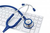 foto of diagnostic medical tool  - stethoscope and keyboard of a computer - JPG
