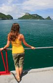 Young Woman Admiring Scene From A Boat, Ang Thong National Marine Park , Thailand
