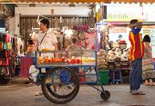 BANGKOK, THAILAND - JANUARY 9, 2012: Local man stands behind his street food cart on Khao San Road.