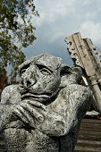 image of junk-yard  - A gargoyle stands guard in a junk yard - JPG