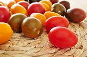picture of plum tomato  - closeup of some baby plum tomatoes of different colors - JPG