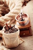 coffee grinder with coffee beans in sack - coffee time