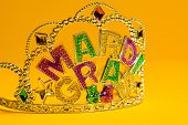 pic of crown jewels  - A jeweled Mardi Gras crown on a yello backgroung - JPG