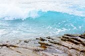 picture of elm  - Clear turquoise wave on rocks in Sant Elm Majorca - JPG