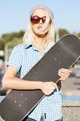 Beautiful Blonde Girl In  Hat  Sunglasses With Skateboard