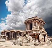 image of chariot  - Stone chariot in courtyard of Vittala Temple at blue overcast sky in Hampi Karnataka India - JPG