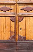 An Old Wooden And Grungy Locked Door