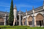 Ornamental Gothic Archs And Garden In Medieval Monastery(Portugal)