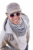 Sexy Man Smiling In Sweatshirt With Sunglasses Wearing Cap And Scarf