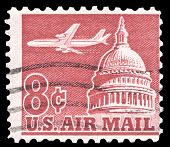 USA-CIRCA 1962: An 8 cent United States Airmail postage stamp shows image of Jetliner Over Capitol Building, circa 1962.