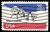 USA-CIRCA 1974: A 21 cent US Airmail  stamp, shows image of Mount Rushmore with  iconic faces of  ,