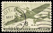 USA-CIRCA 1944: An 8 cent United States Airmail postage stamp shows image of a twin-engined transpor