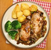 Coq au vin, chicken cooked in red wine sauce