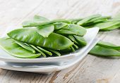 stock photo of snow peas  - Snow Peas on a wooden table  - JPG
