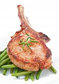 Juicy grilled pork fillet steak with with green beans