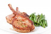 picture of pork cutlet  - Juicy grilled pork fillet steak with with green beans - JPG