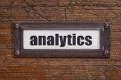 analytics tag - file cabinet label, bronze holder against grunge and scratched wood