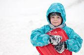 picture of sled  - Boy with sleds on the hill in a Winter - JPG