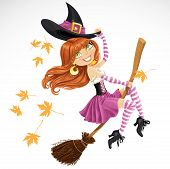 Beautiful witch flying on a broomstick