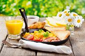 stock photo of scrambled eggs  - healthy breakfast with scrambled eggs juice and fruits on wooden background - JPG