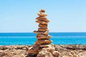 Balanced Stones, Pebbles Stacks Against Blue Sea.