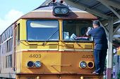 Train driver clean window of Alsthom Diesel locomotive