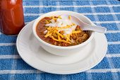 Chili With Cheese And Onions Spoon In Bowl