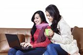 Cheerful two women shopping online