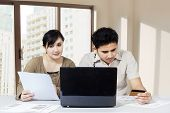 Couple Paying Bill Online