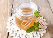 foto of jar jelly  - Homemade mint jelly in glass jar - JPG