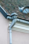 foto of gutter  - Old rain gutter with weathered tiled roof - JPG