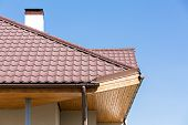 image of gutter  - Corner of a house with gutter and tiled roof - JPG