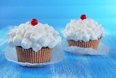 picture of sugarpaste  - Tasty cupcake on table - JPG