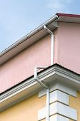 picture of downspouts  - House corner rain gutters and metal downspout - JPG