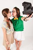Young Nerdy Girls Taking A Selfie With Instant Camera.