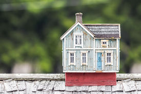 image of shingles  - Miniature house on a rooftop with shingles - JPG
