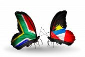 Two Butterflies With Flags On Wings As Symbol Of Relations South Africa And Antigua And Barbuda